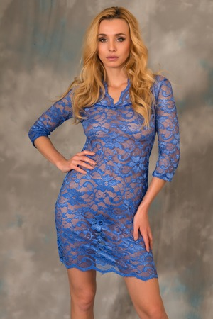Beautiful slender Czech blonde in a blue lace dress