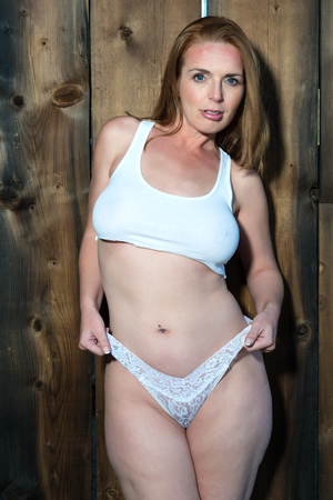 undergarment: Beautiful tall redhead in a crop top and panties Stock Photo