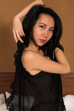 undergarment: Pretty slender Chinese woman in black lingerie Stock Photo