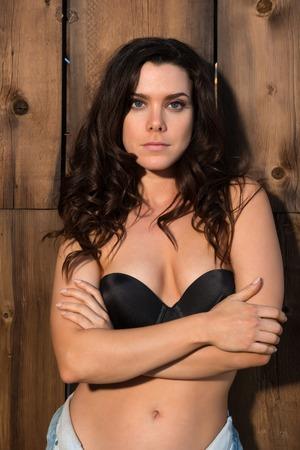 black bra: Pretty young brunette in a black bra and denim shorts