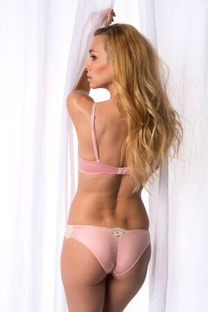 Beautiful slender Czech blonde in pink lingerie