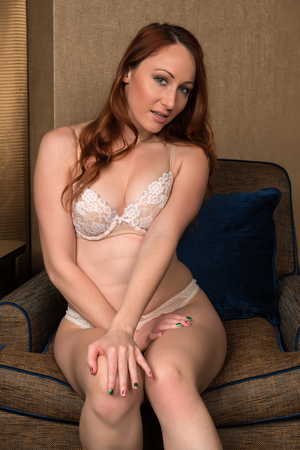undergarment: Pretty young redhead in cream and beige lingerie