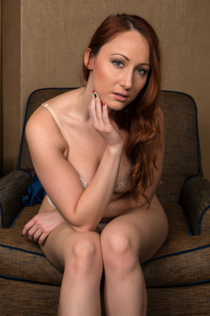 redhead lingerie: Pretty young redhead in cream and beige lingerie