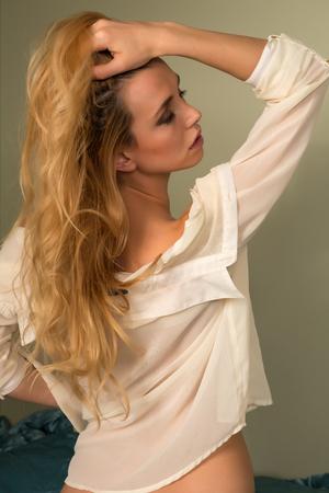 czech women: Beautiful slender Czech blonde in a pale yellow blouse Stock Photo