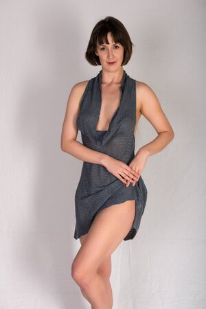 statuesque: Statuesque young brunette in a gray knit dress