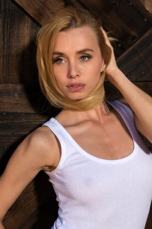 Beautiful slender Czech blonde in a white tank top
