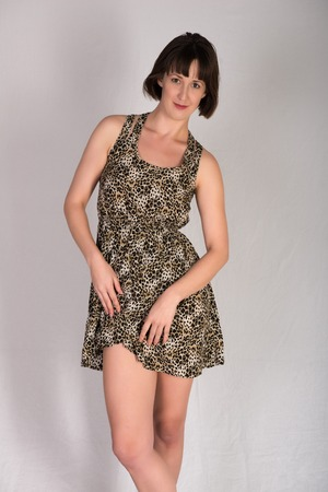 statuesque: Statuesque young brunette in a leopard print dress
