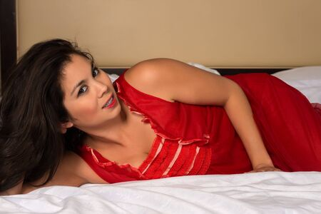 nightgown: Beautiful young Eurasian woman in a red nightgown