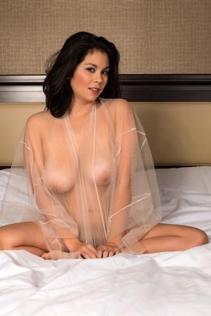 Beautiful young Eurasian woman in a beige wrap photo