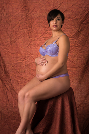 blue lingerie: Young expectant mother dressed in blue lingerie