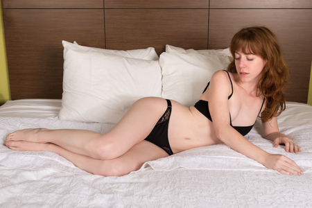petite girl: Petite young Irish redhead in black lingerie