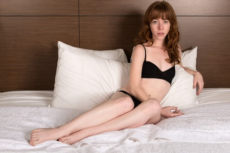 Petite young Irish redhead in black lingerie
