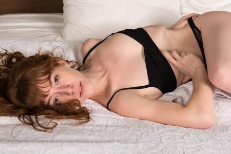 redhead lingerie: Petite young Irish redhead in black lingerie