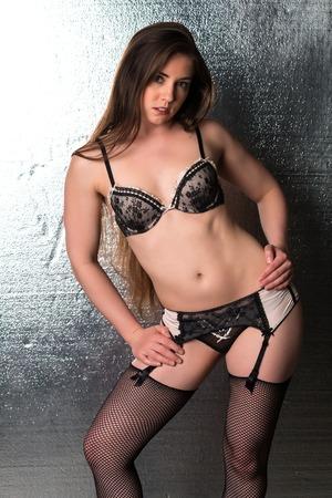 garters: Pretty petite brunette in black and beige lingerie