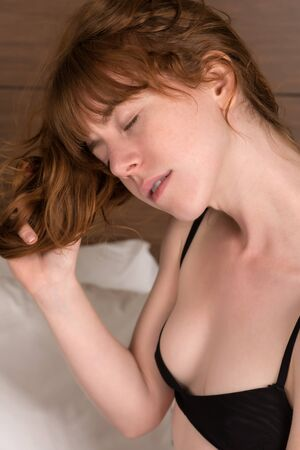 irish woman: Petite young Irish redhead in black lingerie