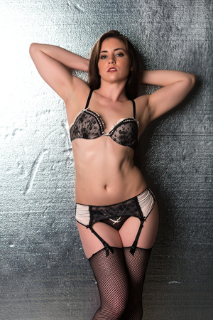 garter belt: Pretty petite brunette in black and beige lingerie