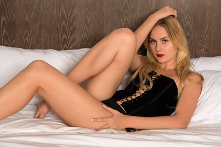 black lingerie: Beautiful tall Russian blonde in black lingerie