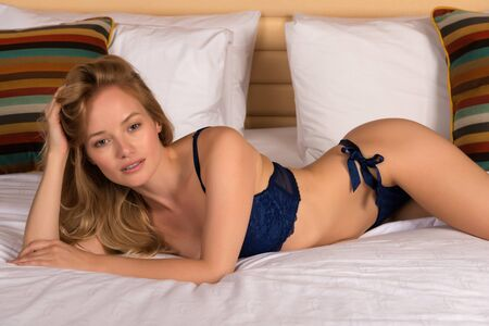 blue lingerie: Beautiful young Hungarian blonde in blue lingerie Stock Photo