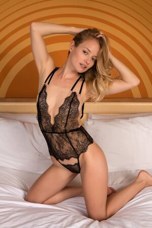 undergarment: Beautiful young Hungarian blonde in black lingerie