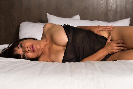 buxom: Pretty mature brunette in a brown bodysuit