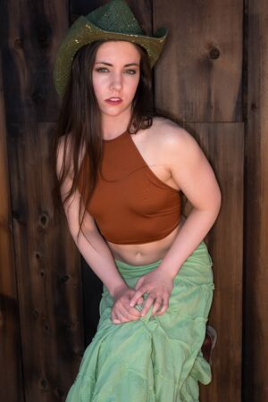 halter: Pretty petite brunette in a brown halter top and long green skirt;