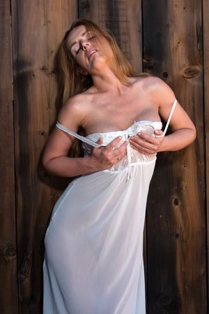 negligee: Beautiful tall redhead in a white lace negligee Stock Photo