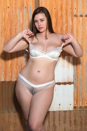 revealing: Pretty shapely brunette in revealing white lingerie