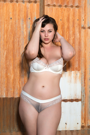 shapely: Pretty shapely brunette in revealing white lingerie