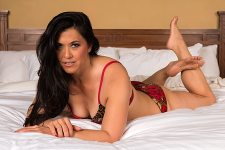 Pretty mature Eurasian woman in red lingerie