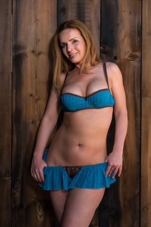 redhead lingerie: Beautiful tall redhead in vintage blue lingerie Stock Photo
