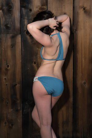 sexy young girl: Pretty petite brunette in a blue bikini