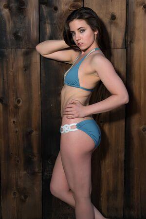 girl with long hair: Pretty petite brunette in a blue bikini