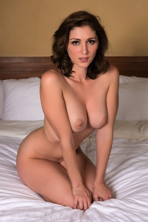 sexy nude women: Beautiful young brunette sitting nude in bed