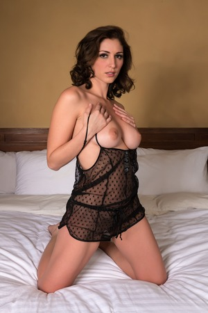 sexy nude women: Beautiful young brunette in a black bodysuit