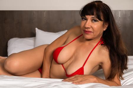 mature brunette: Pretty mature brunette in a red bikini