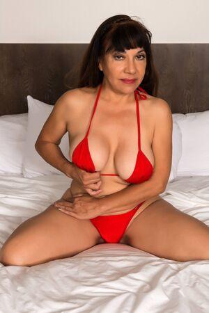 Pretty mature brunette in a red bikini