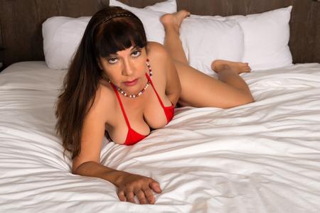 buxom: Pretty mature brunette in a red bikini