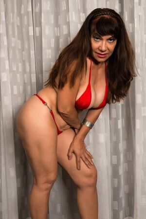 brown skin: Pretty mature brunette in a red bikini