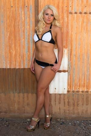 black bikini: Beautiful young Russian blonde in a black and white bikini Stock Photo