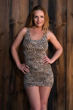 leopard print: Beautiful tall redhead in a leopard print dress