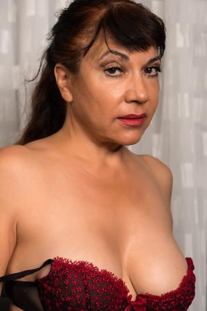 mature brunette: Pretty mature brunette in red and black lingerie