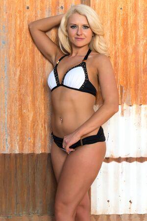 Beautiful young Russian blonde in a black and white bikini Stock Photo