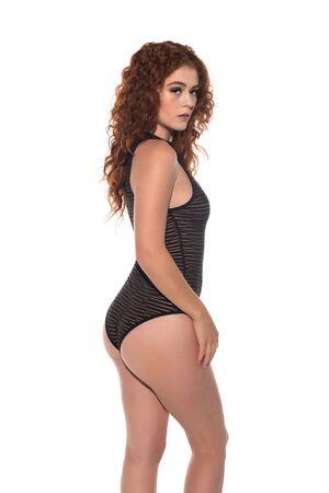 Petite redhead in a black bodysuit