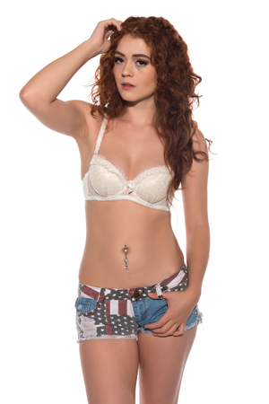 undergarment: Petite redhead in a white bra and Stars and Stripes shorts