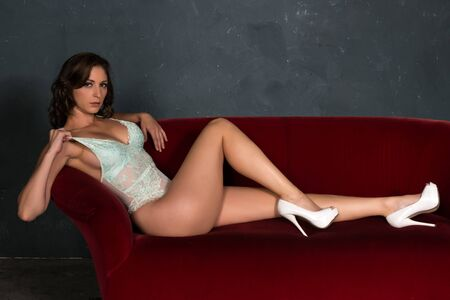 teal: Beautiful shapely brunette in a teal bodysuit Stock Photo