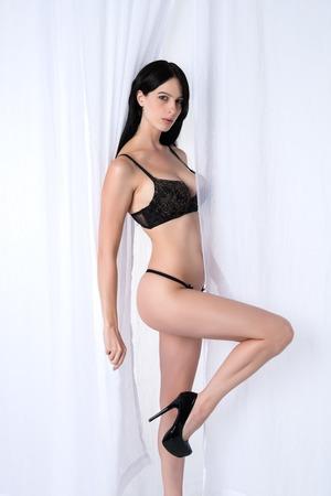 black lingerie: Slender young brunette dressed in black lingerie Stock Photo