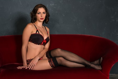 panty hose: Beautiful shapely brunette in red and black lingerie