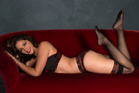 undergarment: Beautiful shapely brunette in red and black lingerie