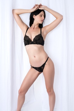 black lingerie: Tall slender brunette dressed in black lingerie