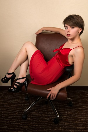 red dress: Pretty young brunette in a red dress Stock Photo